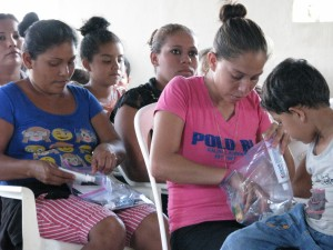 Ladies looking through their hygiene kits.
